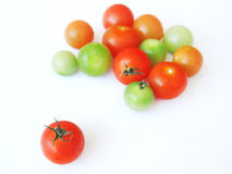Tomatoes in red, green orange Royalty Free Stock Image