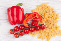 Tomatoes, red pepper and macaroni on table. Tomatoes, red pepper and macaroni on white table Stock Photography