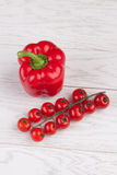 Tomatoes and red pepper on table. Fresh cherry tomatoes and red pepper on a white wooden table Stock Photos