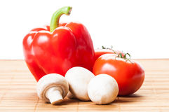 Tomatoes, red pepper, and white mushrooms Stock Photos