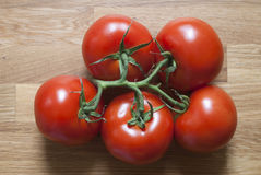 Tomatoes. Red tomatoes on a wooden background Royalty Free Stock Photography