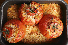 Tomatoes with Rice. Closeup of a typical italian food: tomatoes filled with rice stock photo