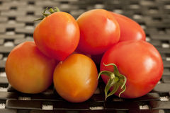 Tomatoes Ripe Pile. A pile of ripe tomatoes on a black grate Royalty Free Stock Image