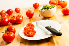 Tomatoes And Rocket Leaves In A Kitchen Stock Images
