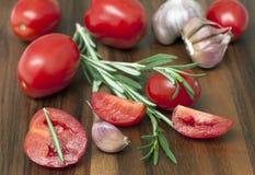Tomatoes, rosemary and garlic Stock Image