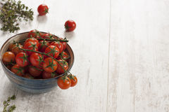 Tomatoes and rosemary herbs Royalty Free Stock Images