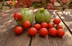 Tomatoes with round zucchini Stock Photos