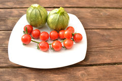 Tomatoes with round zucchini Royalty Free Stock Photo
