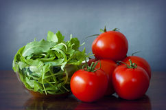 Tomatoes and rucola salad Stock Photos