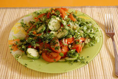 Tomatoes salad. Fresh cut with cucumbers Royalty Free Stock Photography