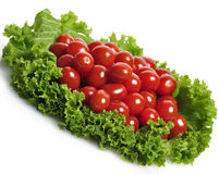 Tomatoes And Salad Leaves Stock Photos