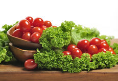 Tomatoes And Salad Leaves Stock Photo