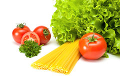 Tomatoes with salad and pasta. On a white background Stock Images