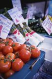 Tomatoes On Sale At Market Stall Stock Photos