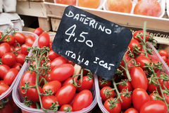 Tomatoes for sale on market stall Stock Image