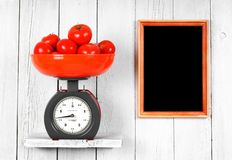 Tomatoes on scales Stock Image