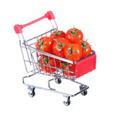 Tomatoes in shopping cart isolated. concept. Royalty Free Stock Photos