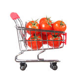 Tomatoes in shopping cart isolated. concept. Stock Photos