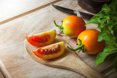 Tomatoes slice on wood ladle Royalty Free Stock Photos