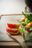 Tomatoes slice on wood ladle Stock Photography