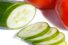 Tomatoes and sliced cucumber Stock Images