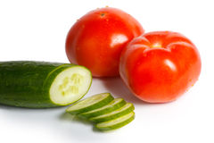 Tomatoes and sliced cucumber Stock Photos