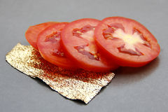 Tomatoes sliced. Tomatoes sliced on  on gray background Royalty Free Stock Photography