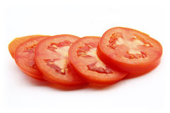 Tomatoes sliced. Tomatoes sliced on isolated on white background Royalty Free Stock Images