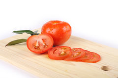 Tomatoes. Slices of tomatoes on a wooden board Stock Image