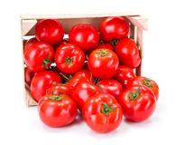 Tomatoes (Solanum lycopersicum) in wooden crate Stock Photo