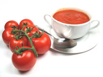 Tomatoes and soup Stock Images