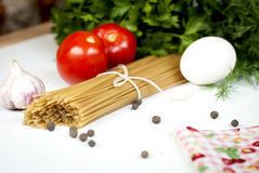 Tomatoes and spaghetti Royalty Free Stock Photography