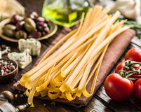 Tomatoes, spaghetti pasta and spices. Royalty Free Stock Photos