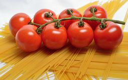 Tomatoes and spaghetti Royalty Free Stock Photos