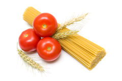 Tomatoes, spaghetti and wheat ears on white background Royalty Free Stock Image