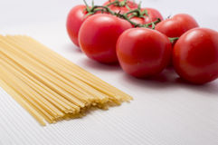 Tomatoes and spaguetti on raw Stock Photo