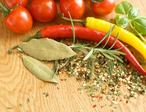Tomatoes and spices. Fresh tomatoes, hot pepper and spices, rosemary, bazil Royalty Free Stock Images