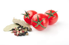 Tomatoes and Spices on White Background. Tomatoes, Peppercorn and Bay Leaves on White Background Stock Image