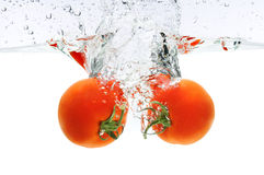 Tomatoes Splashing In Water Royalty Free Stock Images