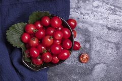 Tomatoes and spoons stock photo