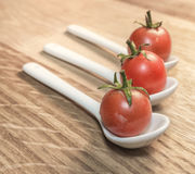 Tomatoes in Spoons Royalty Free Stock Photo
