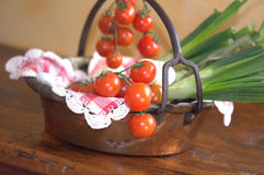 Tomatoes and spring onions Stock Photo