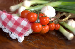 Tomatoes and spring onions in a copper pan Royalty Free Stock Photo