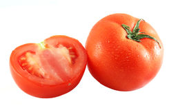Tomatoes sprinkled with water Royalty Free Stock Photo
