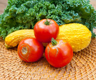 Tomatoes, squash and kale cabbage stems from local garden. Tomatoes, squash and kale cabbage stems from local vegetables garden. selective focus Royalty Free Stock Images