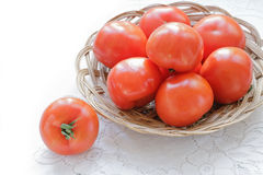 Tomatoes Still Life. Red Tomatoes in a Bowl on a White Table Royalty Free Stock Photos