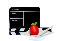 Tomatoes Story. Tomatoes and filmmaker flap on stage Stock Photography