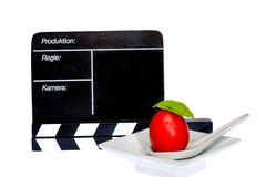 Tomatoes Story. Tomatoes and filmmaker flap on stage Stock Image