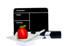Tomatoes Story. Tomatoes and filmmaker flap on stage Royalty Free Stock Photos