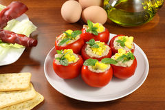 Tomatoes stuffed. With eggs, tuna and cocktail sauce on table Royalty Free Stock Photo